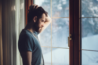 guy looking out window
